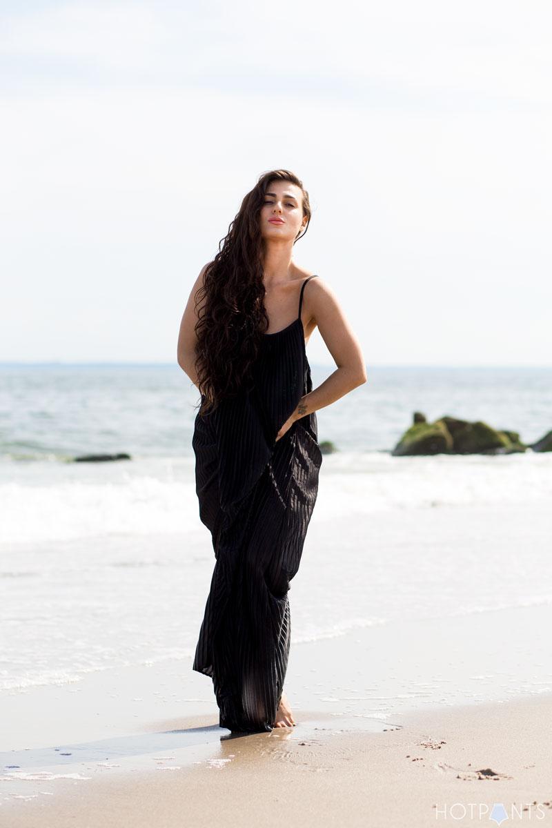 Long Hair Girl Playing At The Beach Ocean