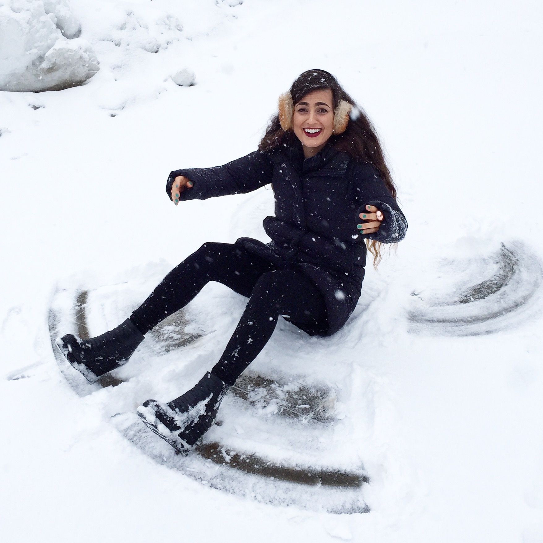 Funny Girl Playing in the Snow Making Snowmen